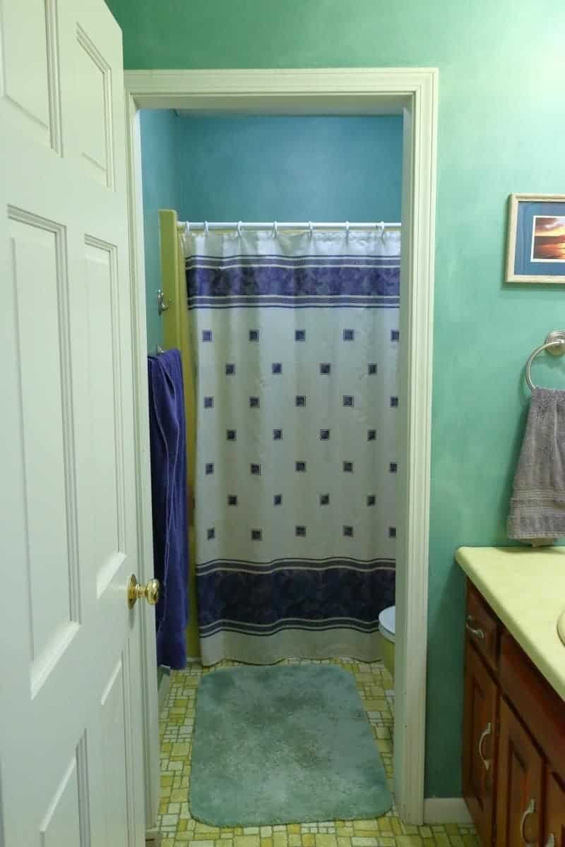 Before picture of 1970s bathroom in Harvest Gold