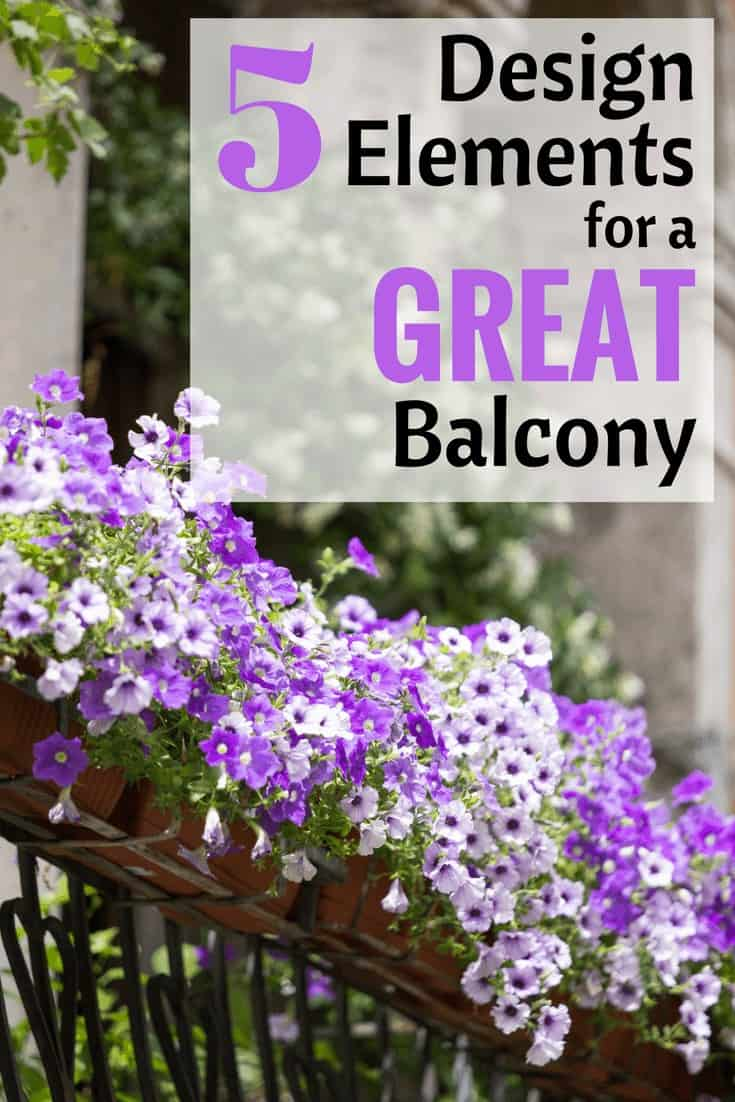 white and purple flowers as a balcony decoration in a flower box