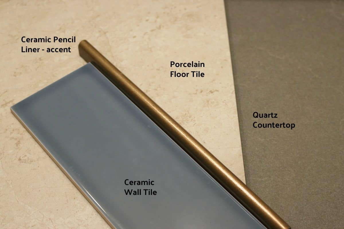 Bathroom material choices - blue tile, taupe floor tile, dark grey countertop