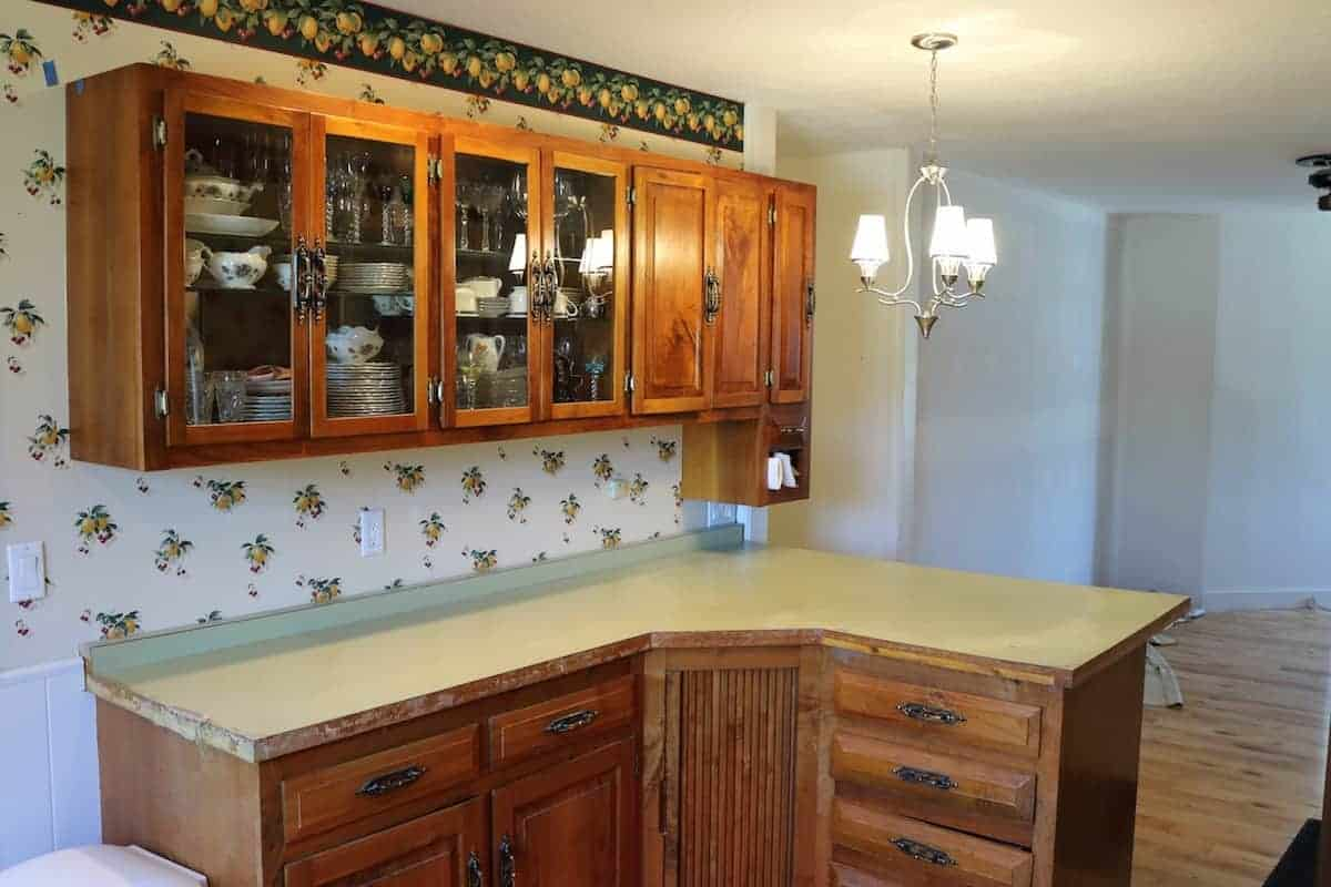 Kitchen remodel before with green formica counters and hickory cabinets