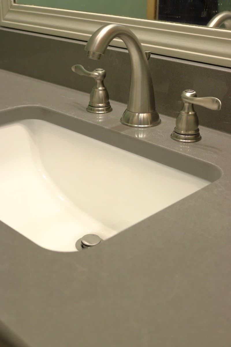 Bathroom remodel - dark grey quartz countertop with white sink
