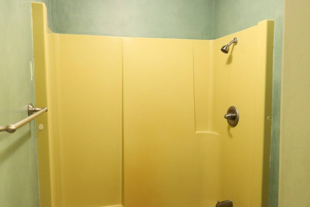 Photo of 1970's Harvest Gold shower surround