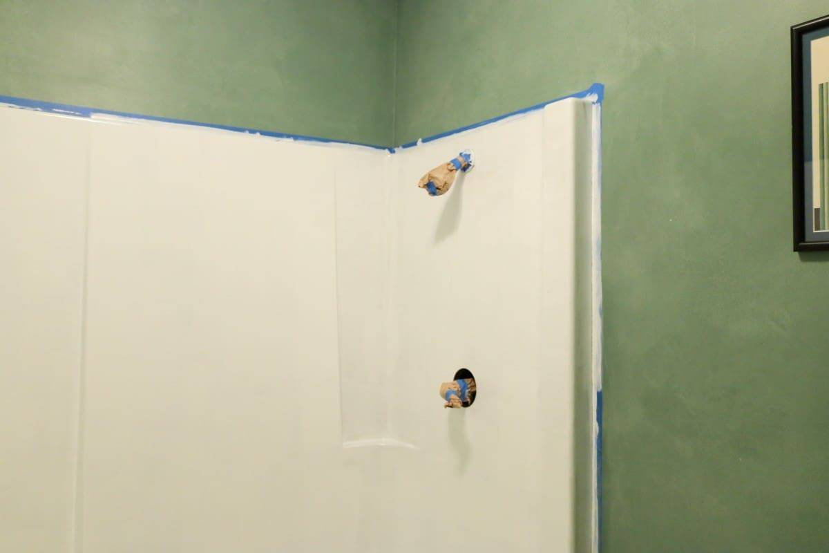 Photo of bathtub refinishing in progress - first coat of white paint