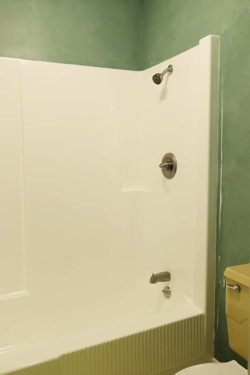 Photo of white fiberglass tub and shower after DIY refinishing