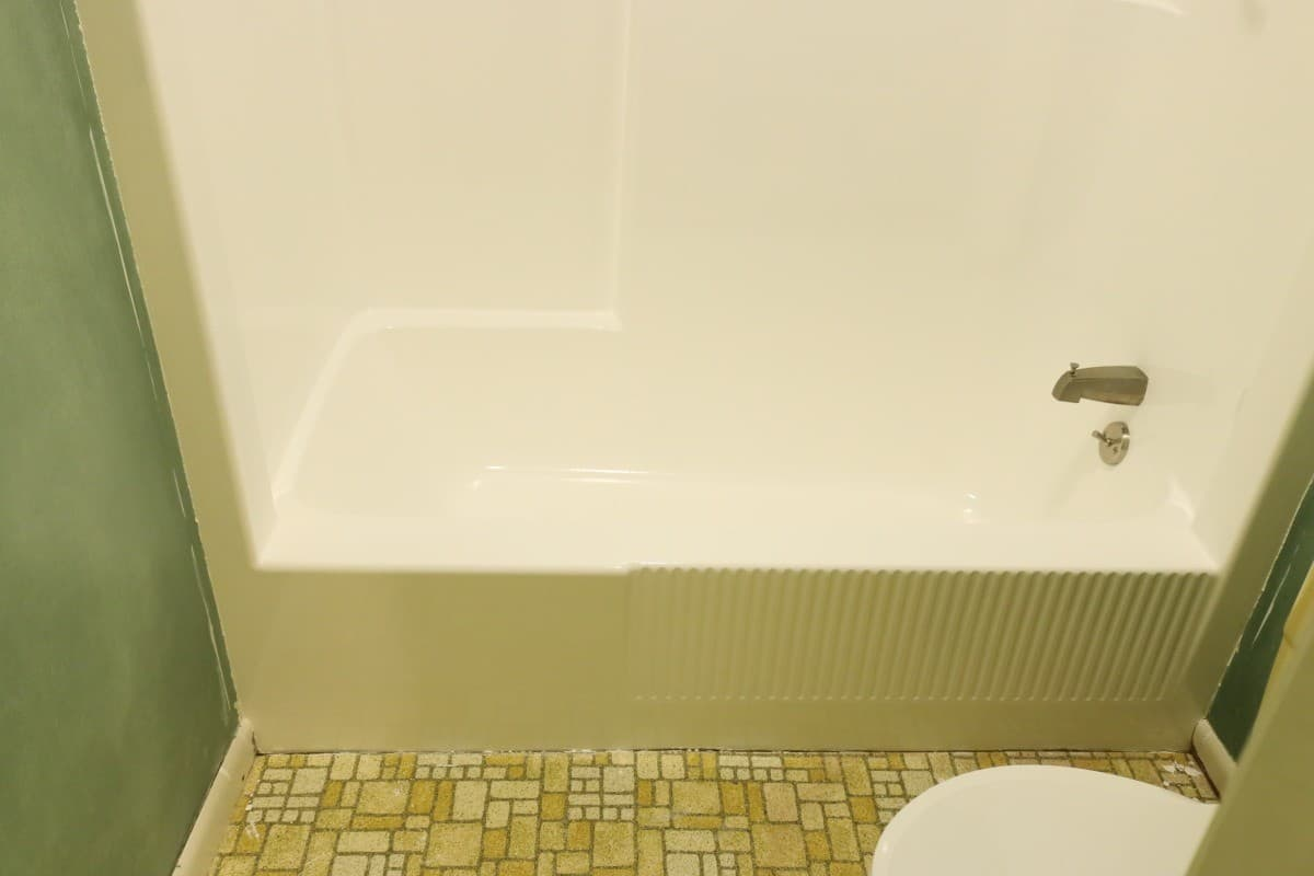 Photo of front of white bathtub after DIY refinishing project