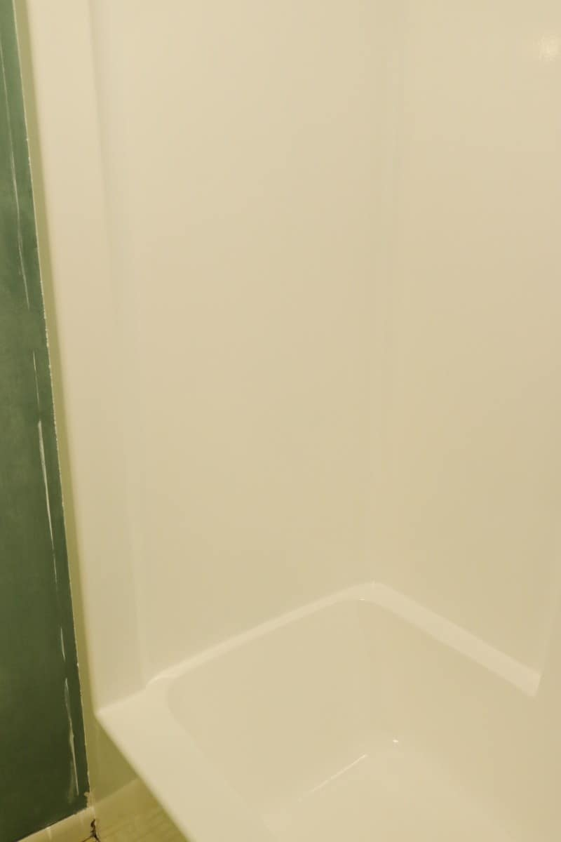 Photo of white tub & shower unit - after DIY bathtub refinishing project