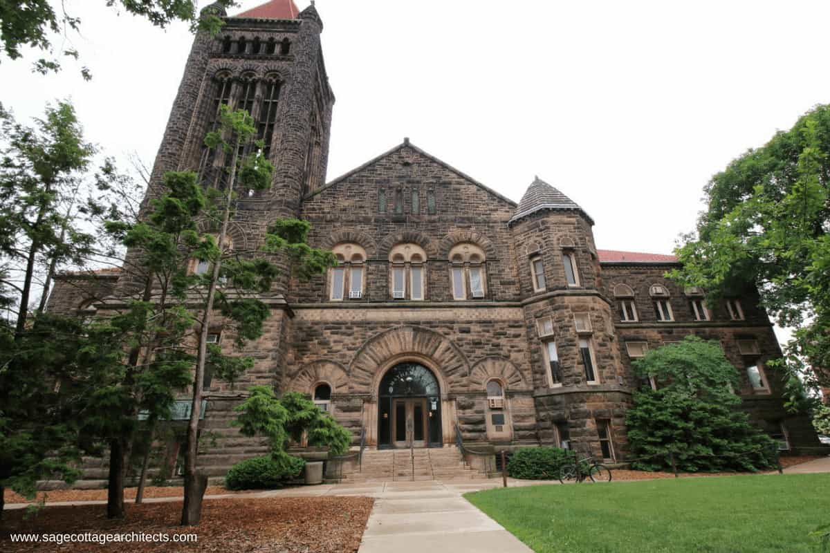 Large Richardsonian Romanesque university building made of stone with bell tower.