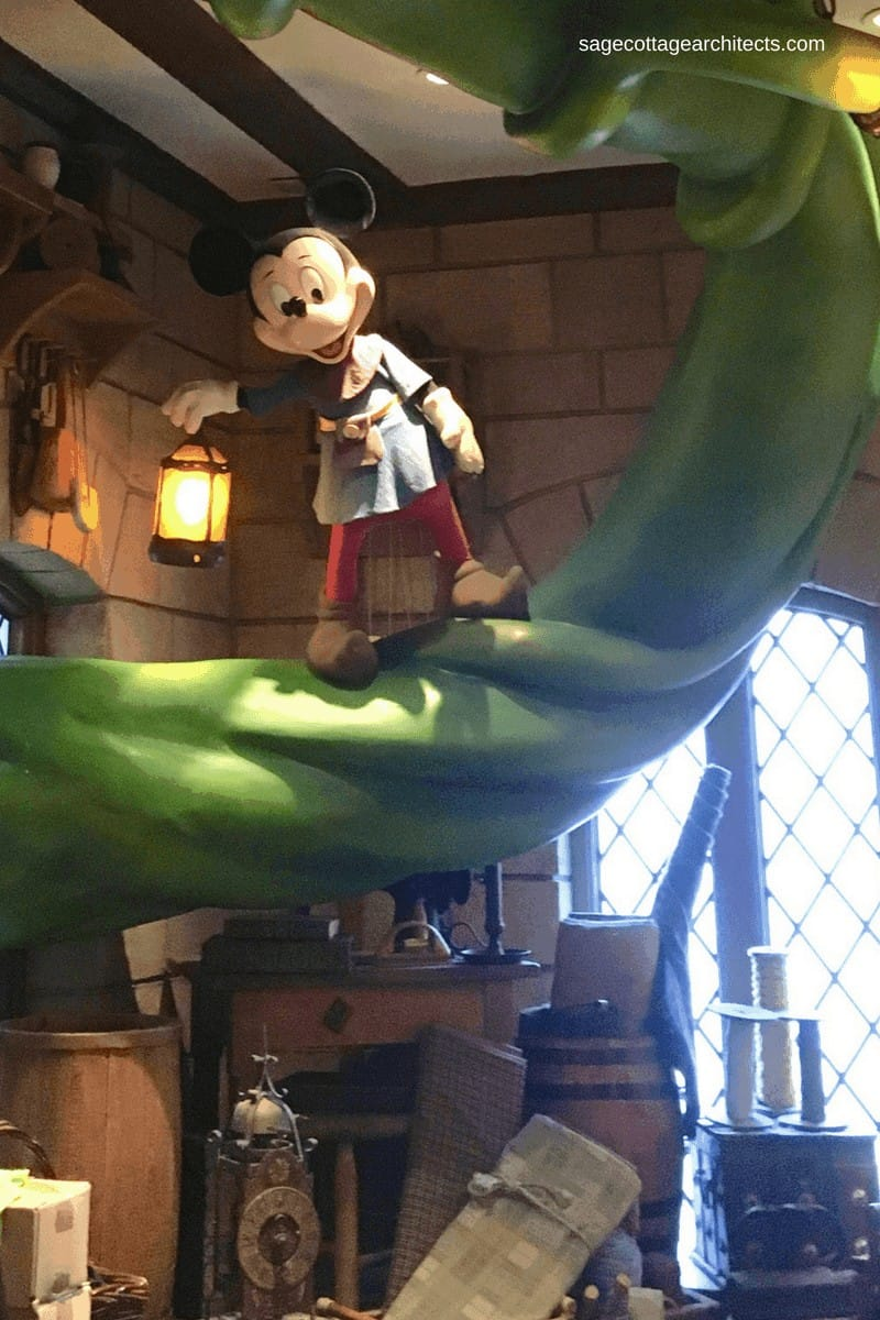 Walt Disney World store interior with Mickey Mouse figure standing on a giant beanstalk.