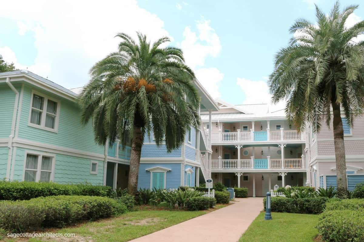 Green, blue, and pink pastel buildings with palm trees at Disney's Old Key West Resort.