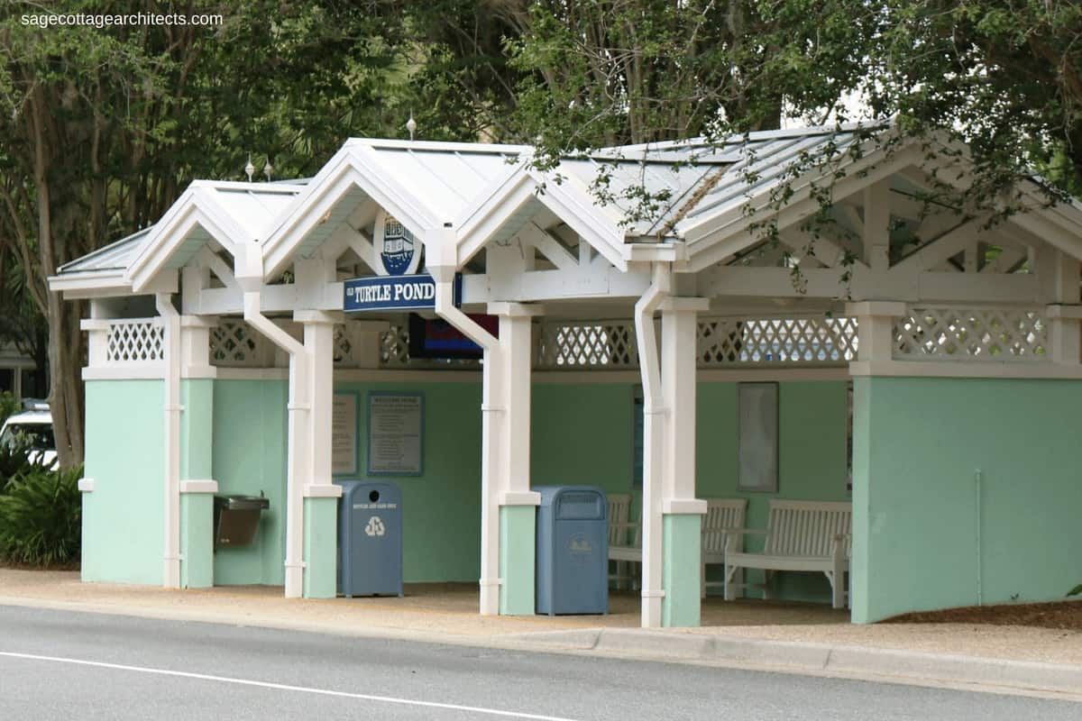 Small mint green covered bus stop with white gingerbread and grey metal roof at Disney's Old Key West Resort