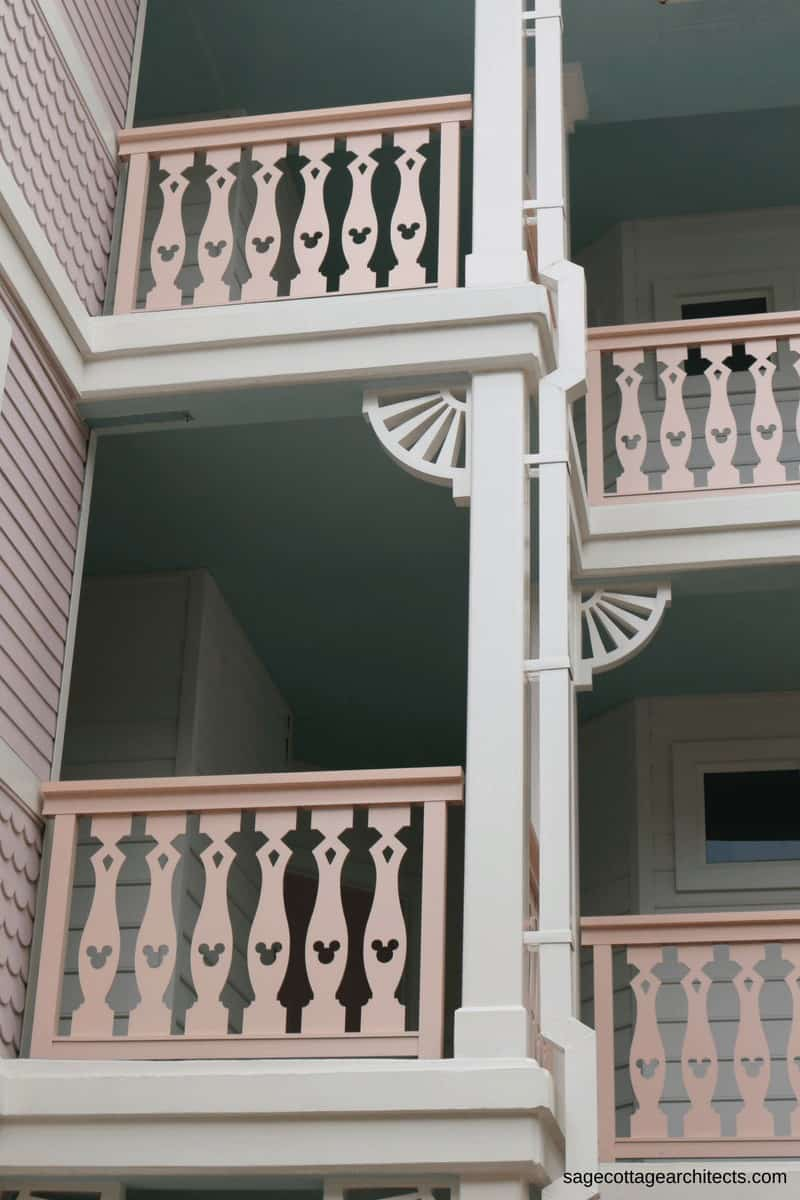 White gingerbread trim and pink balcony railings with Mickey Mouse cutouts at Disney's Old Key West Resort