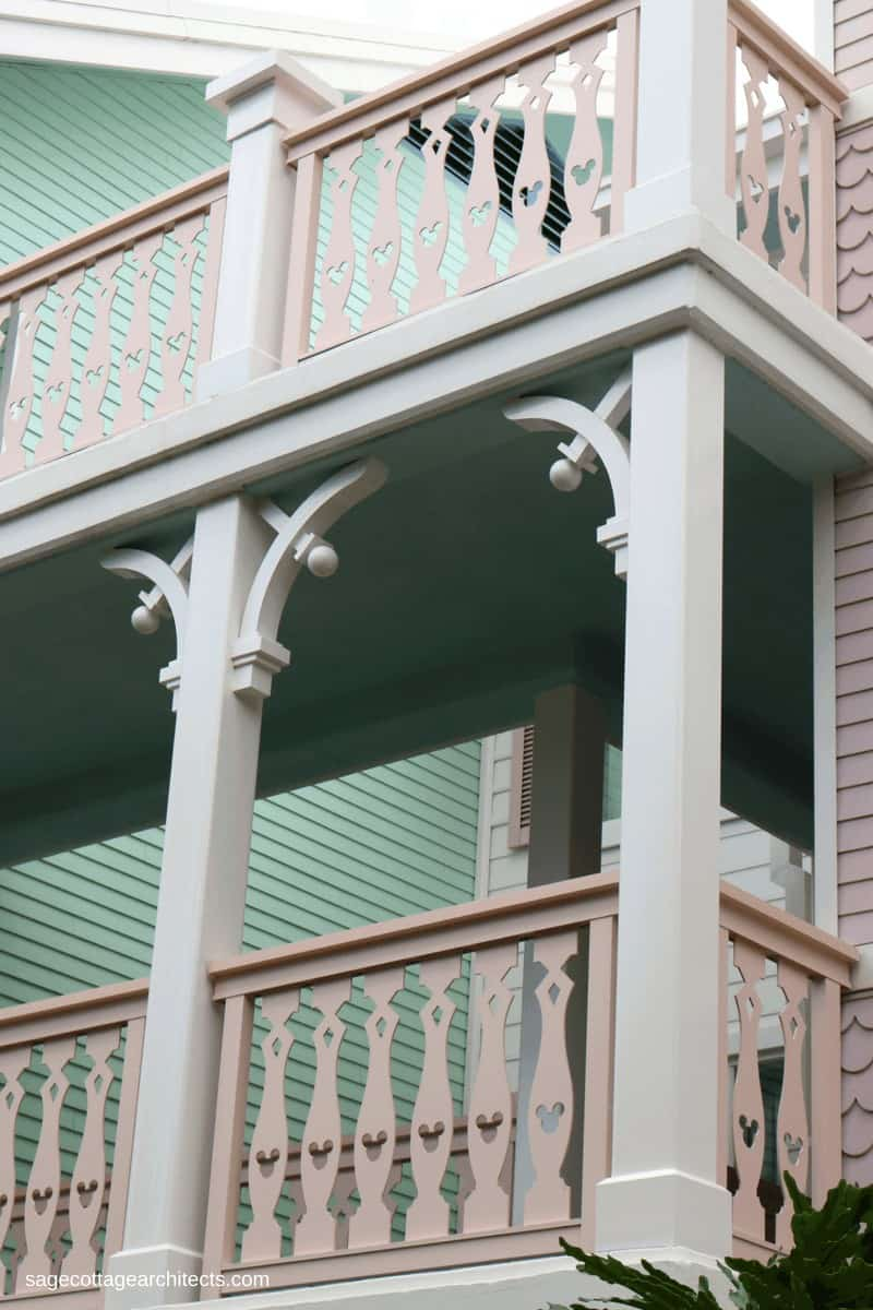 Disney's Old Key West Resort balcony with white gingerbread corbels and pastel pink railing.