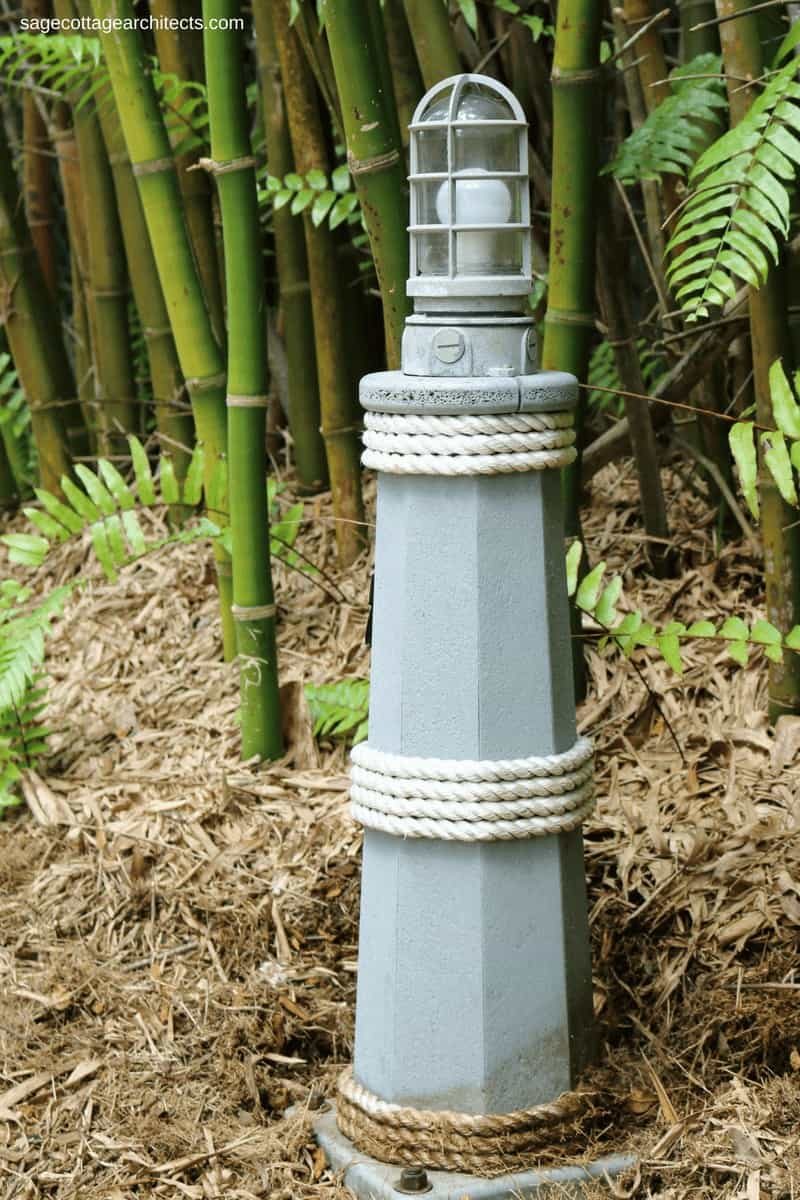 Nautical style light bollard in front of foliage at Disney's Old Key West Resort