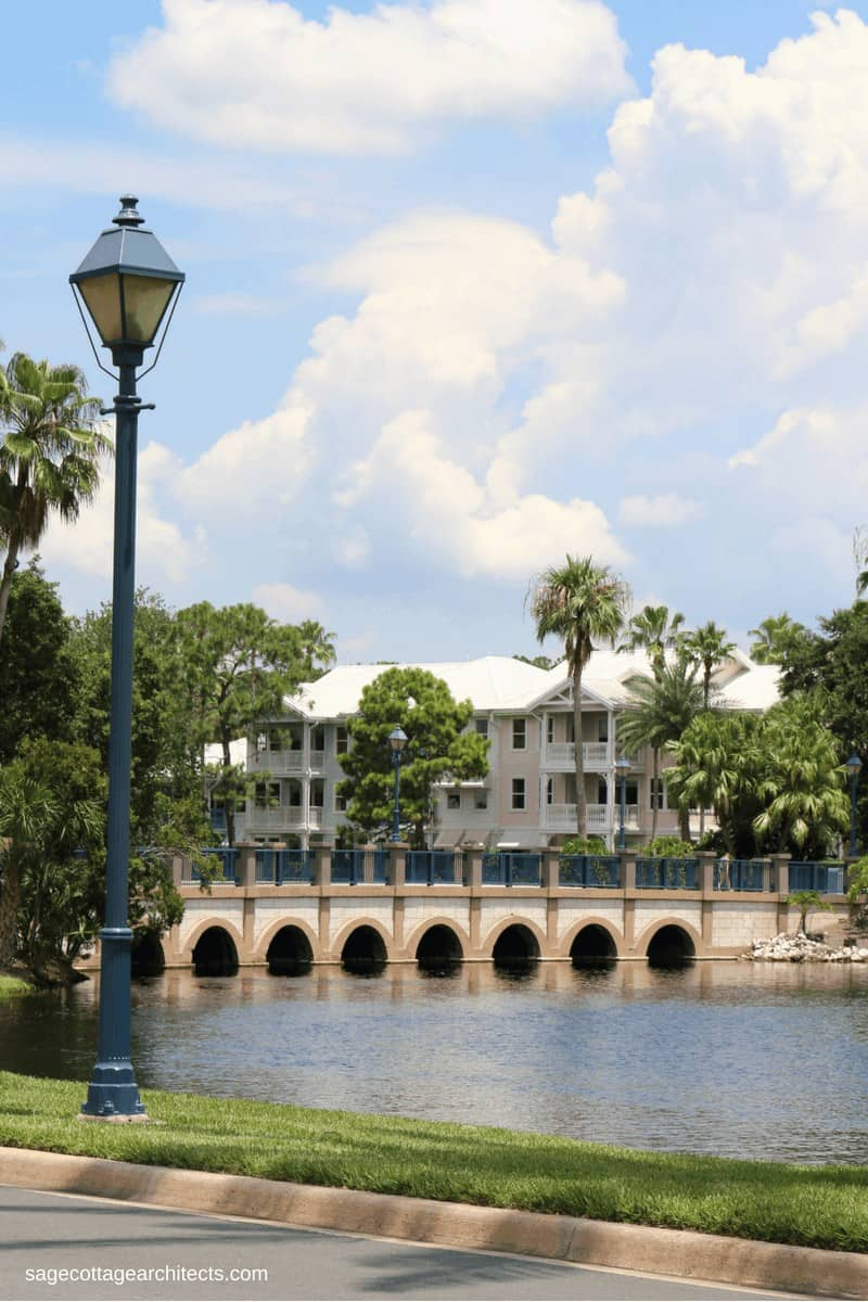 Disney's Old Key West Resort main bridge with seven arched openings and buildings in background.