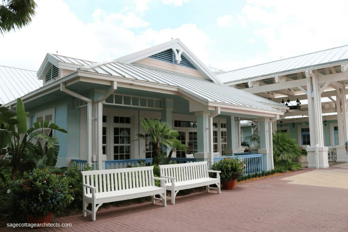 Pastel blue building, white gingerbread, grey metal roof at Disney's Old Key West Resort Hospitality House.