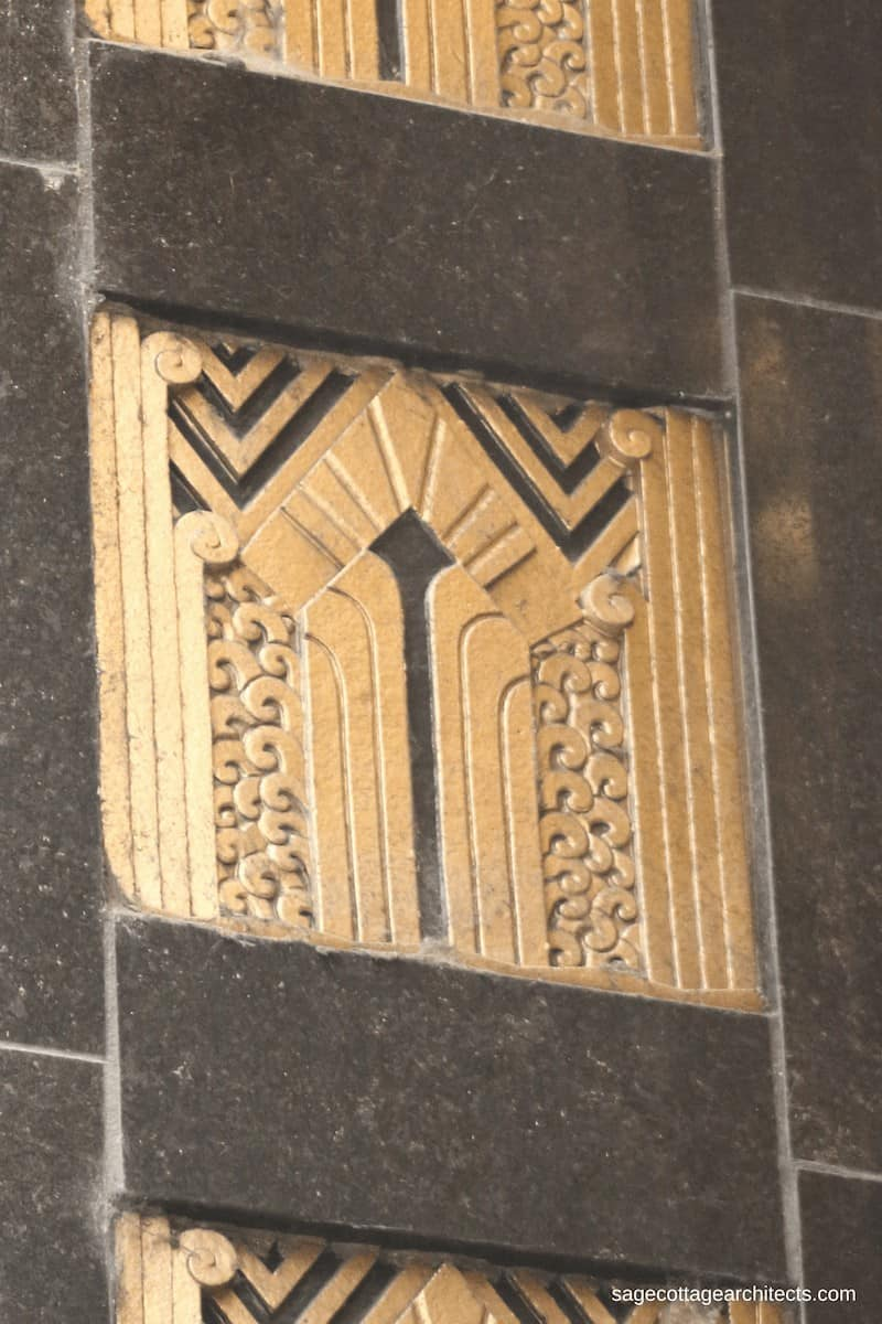 Black and gold Art Deco decorative panel with chevrons