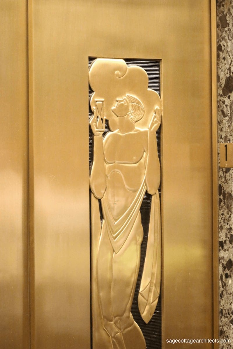 Art Deco gold elevator door with carving of a man holding a sand hour glass