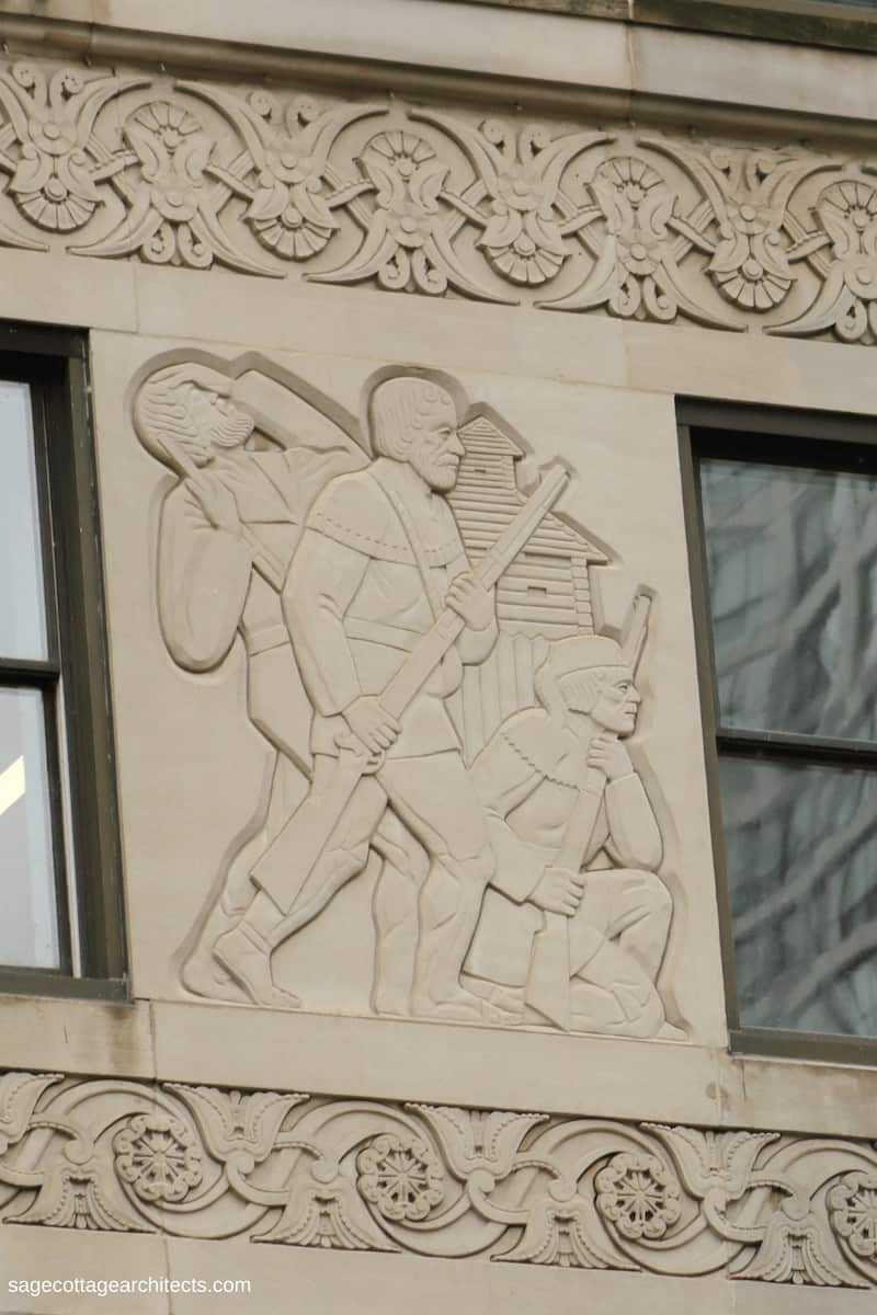 Art Deco panel with relief carving of frontiersmen fighting in front of a fort
