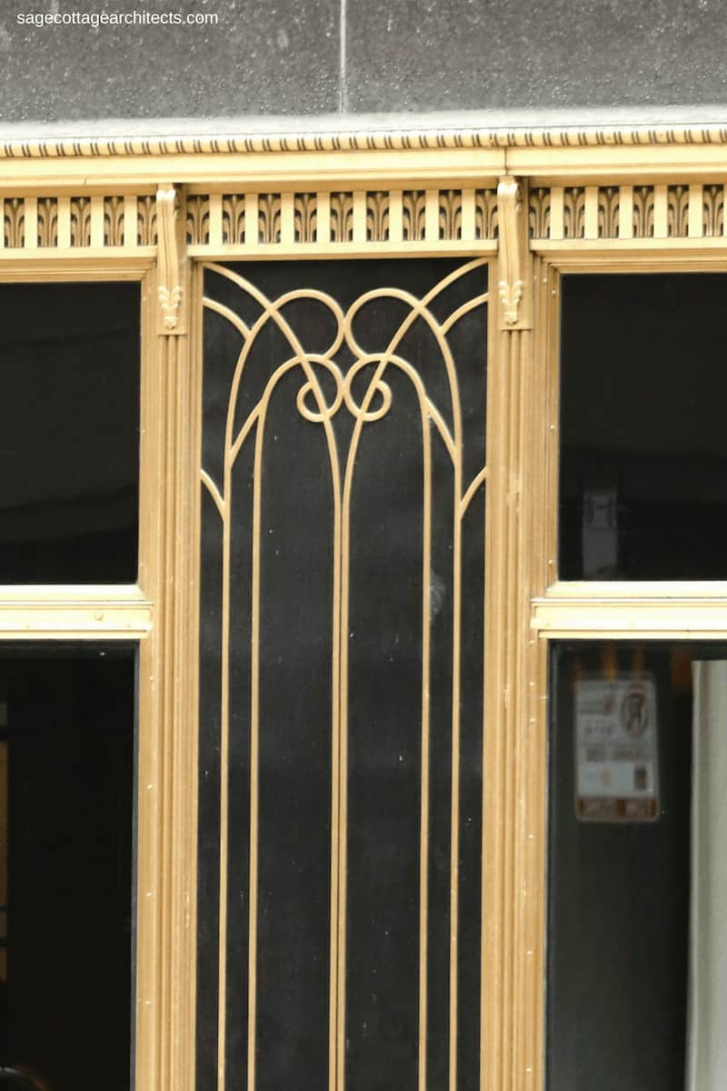 Art Deco bronze ornamentation on the glass storefront of the Carbide and Carbon building.