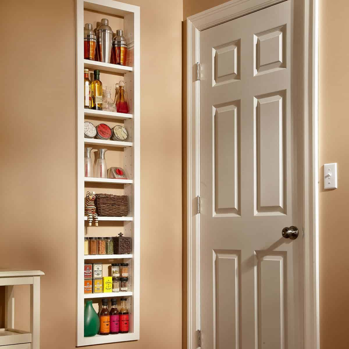 Great storage ideas: cabinet built between the wall studs inside a house
