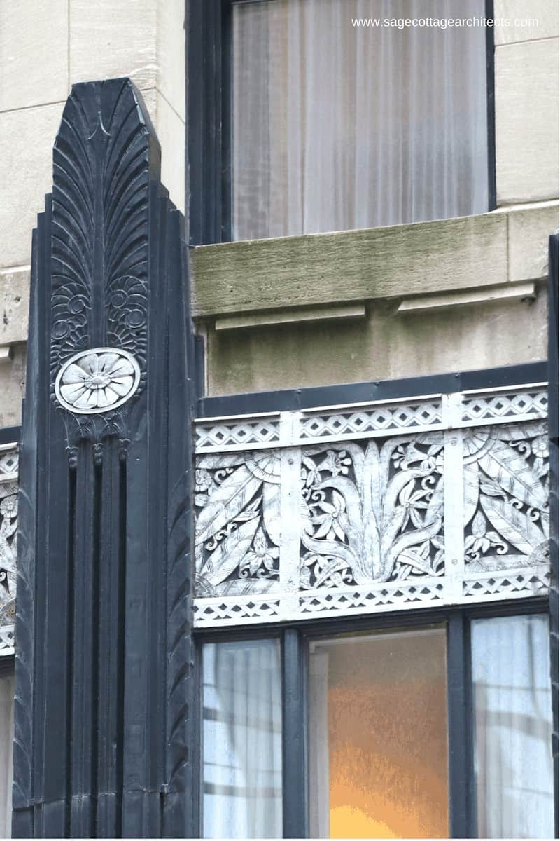 Black Art Deco decorative column, nickel relief panel, and limestone wall