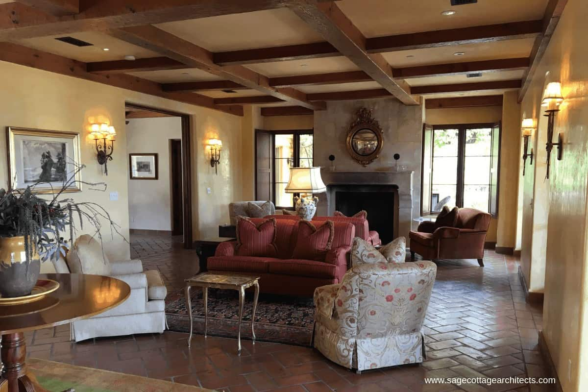 Photo of living room with tile floors and wood beams