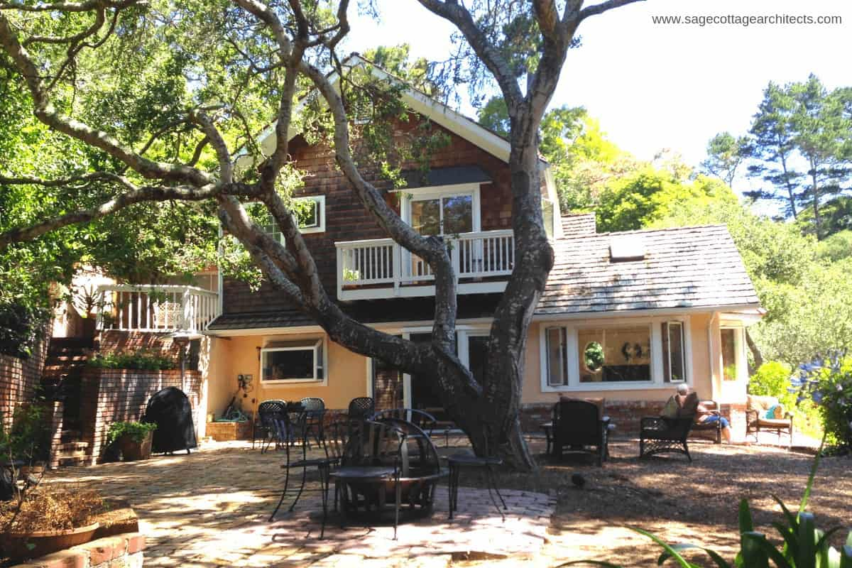 Photo of vacation rental home with large tree.