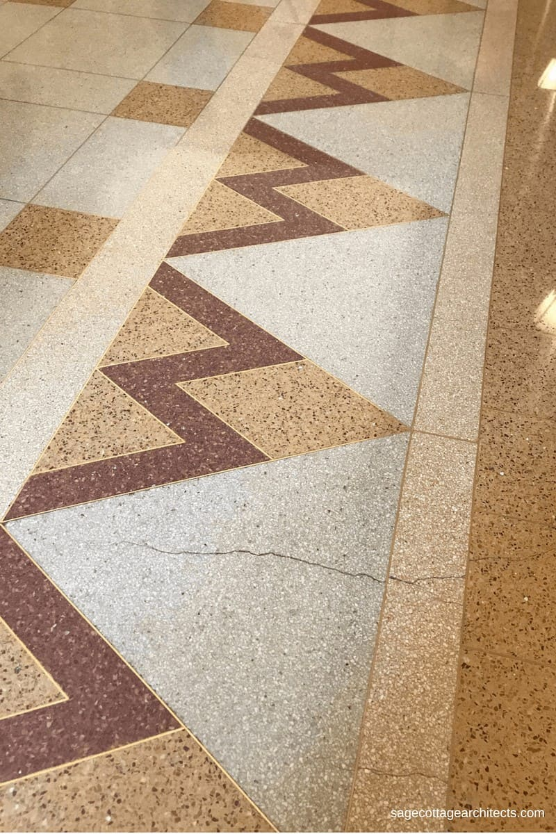 Art Deco style terrazzo floors in a chevron design.