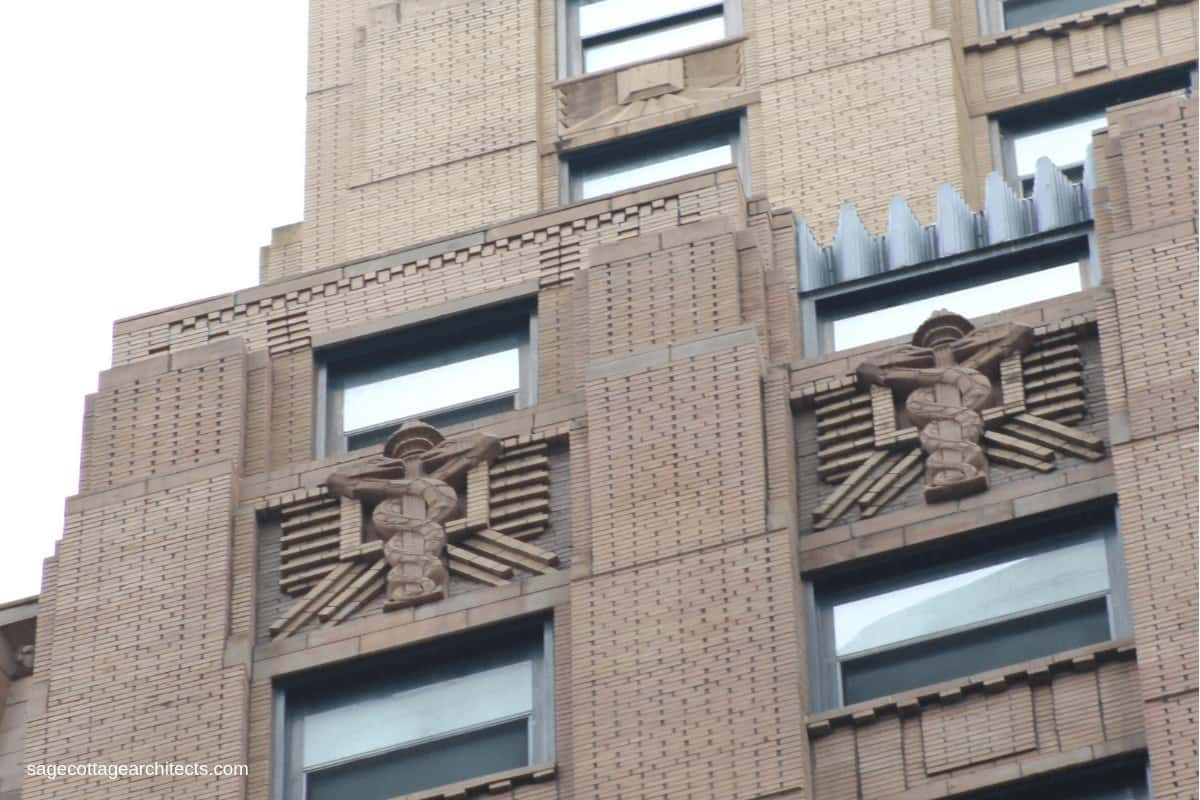 Art Deco building carved decoration of the Staff of Hermes (two snakes entwined about the staff).