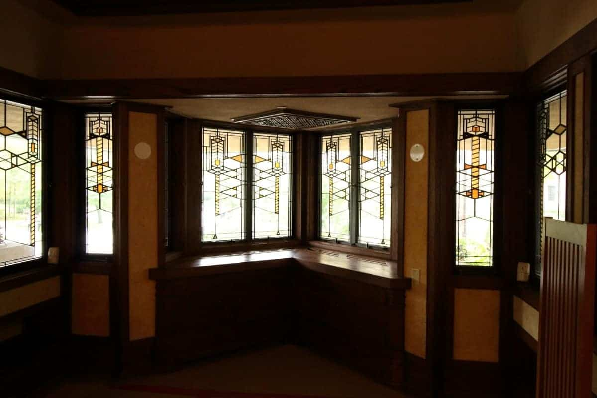 Prairie style home interior with stained glass window band in the Robie House.