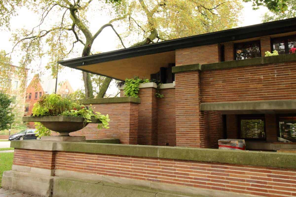 The Robie House in Chicago, with red brick walls, white limestone trim, and cantilevered eaves is the perfect example of Prairie Style homes.