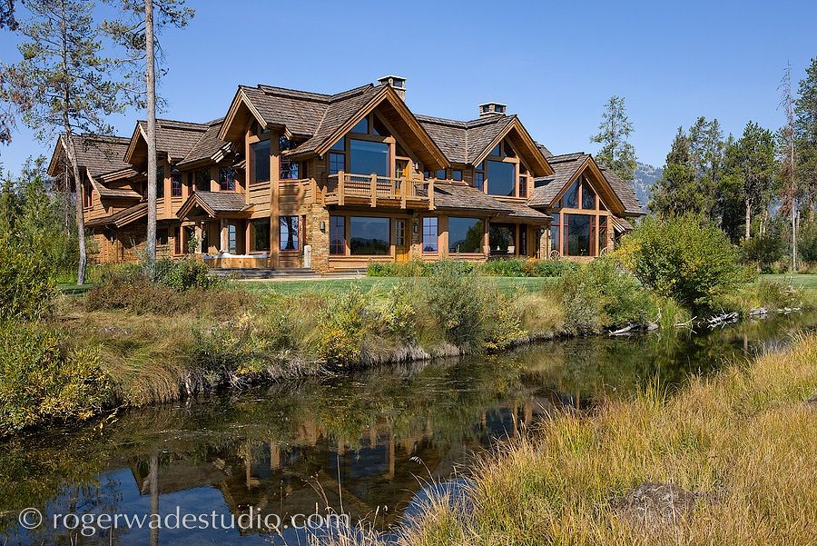 Picture of a large ski vacation home in the summertime.