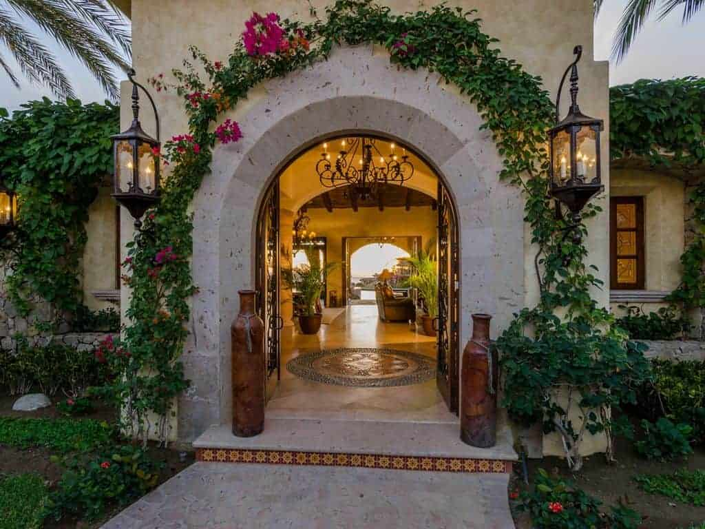 Photo of the entrance to a beach vacation home with limestone archway.