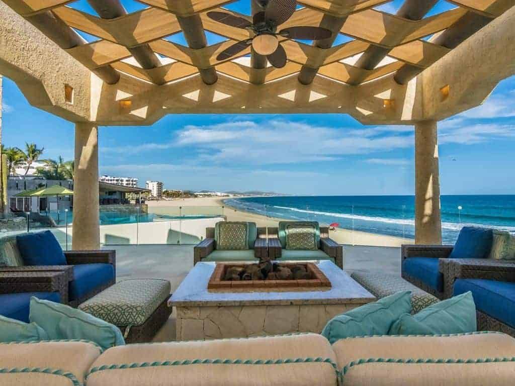 Photo of a covered patio next to the ocean that is the perfect place to enjoy a beach vacation.