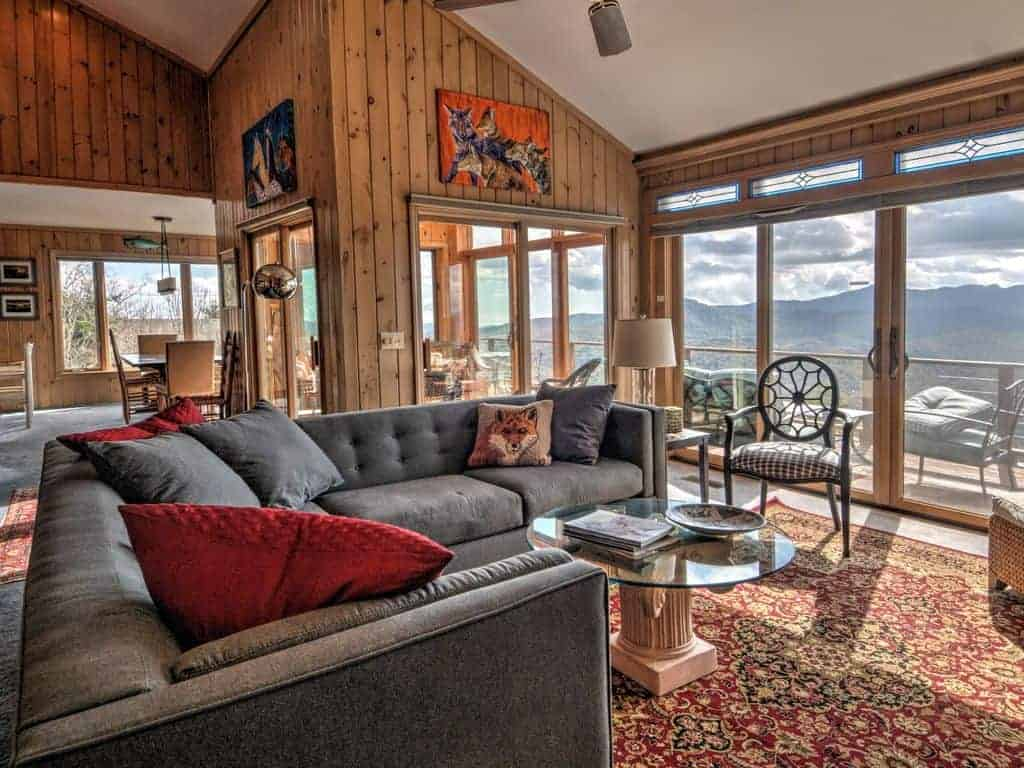Picture of the interior of a ski vacation home looking out to the Smoky Mountains.