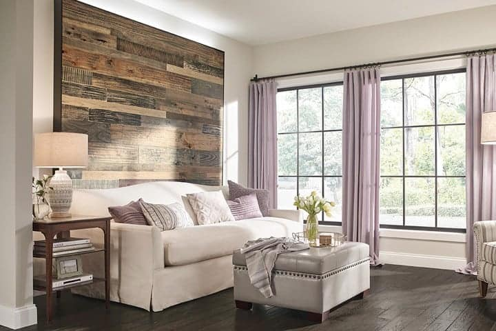 Photo of living room with wood accent wall.