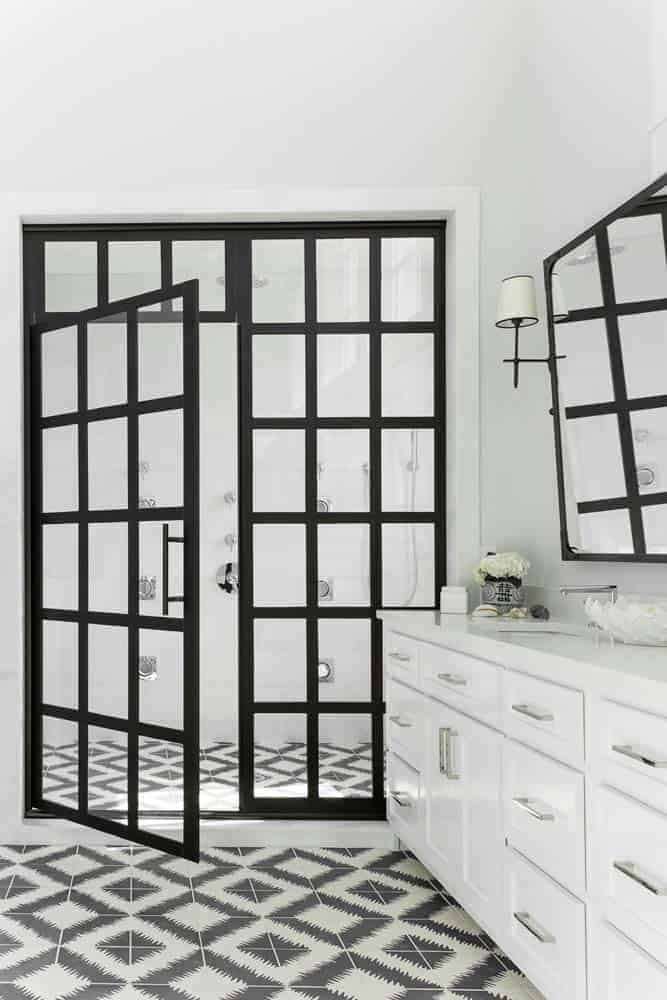 Photo of black framed glass shower enclosure door in a white bathroom.