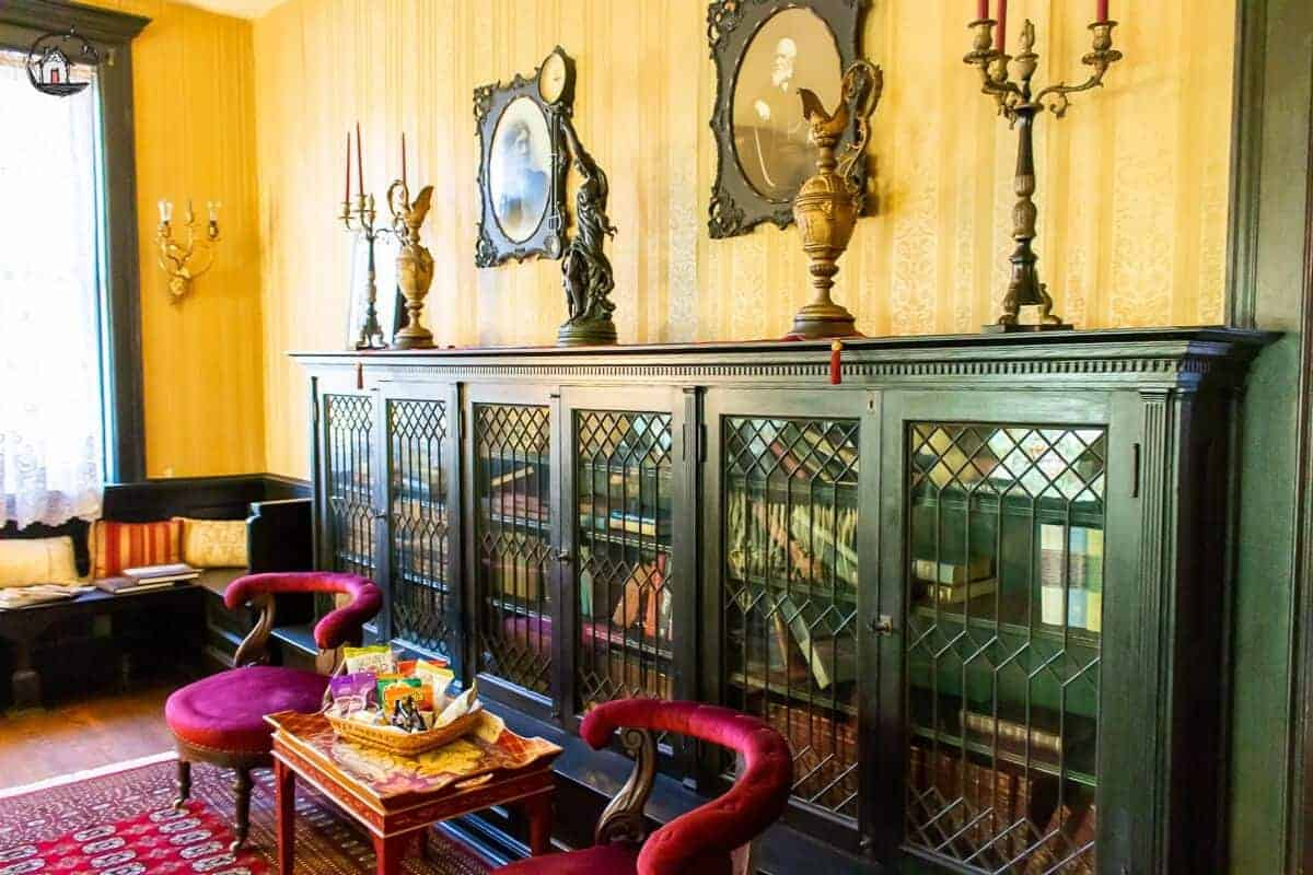 Photo of builtin bookcases with glass front doors in the Vrooman Mansion.