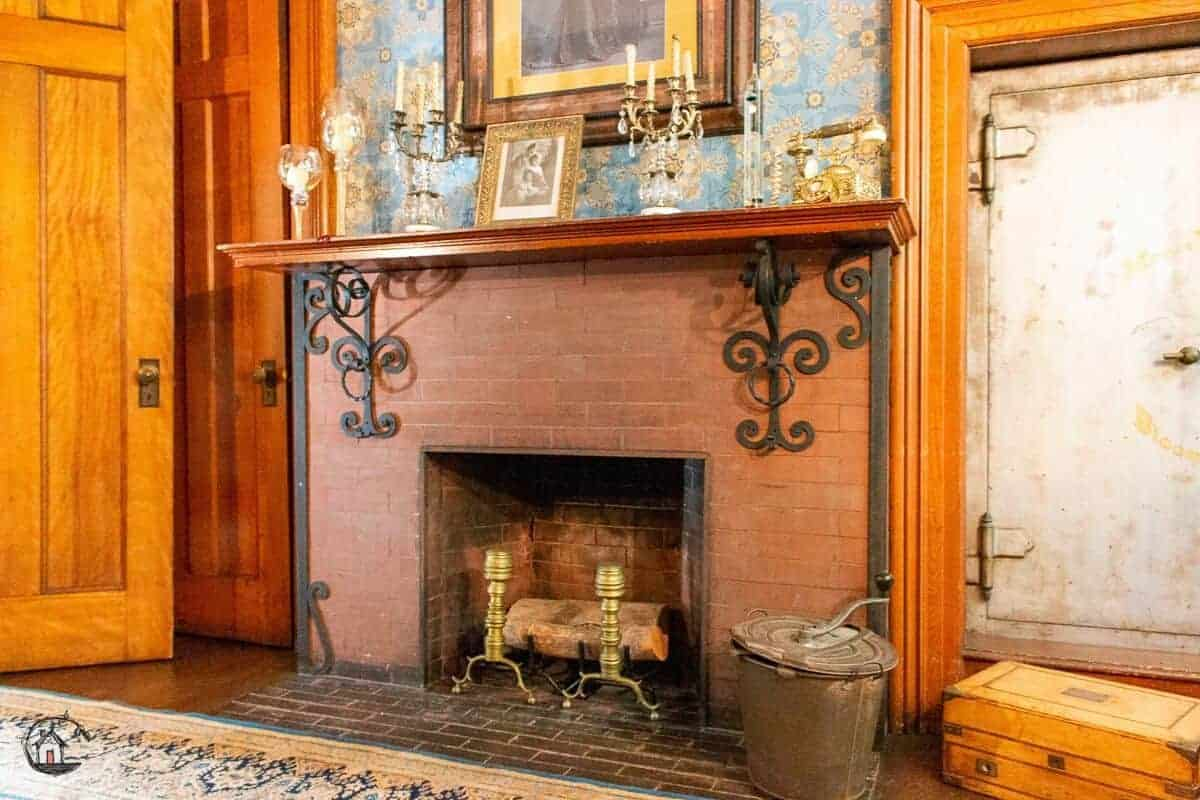Photo of red brick fireplace in the Vrooman Mansion.