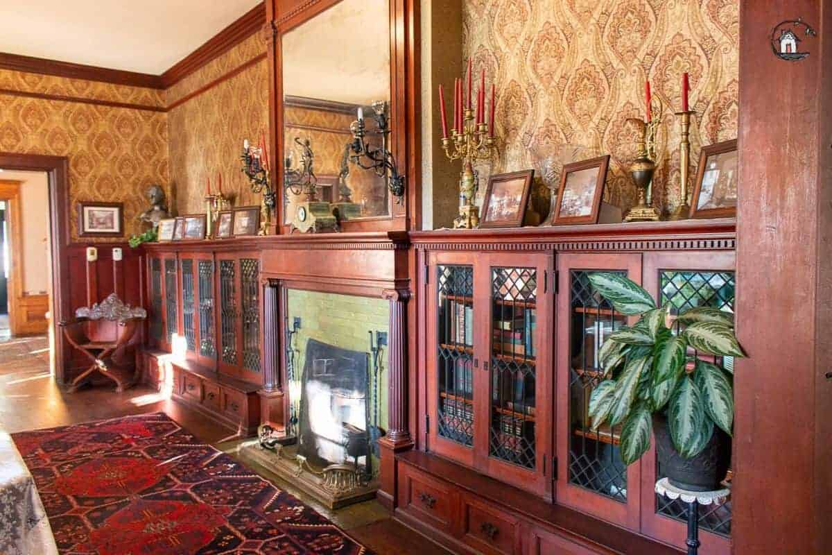 Photo of bookcases with glass doors in the library of the Vrooman Mansion.
