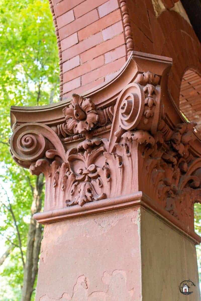 Photo detail of ornate brick column capital on the Vrooman Mansion.