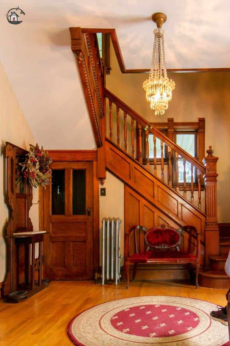 Photo of the interior entry and stairway of an old house. New houses can look to the design of older homes for inspiration.