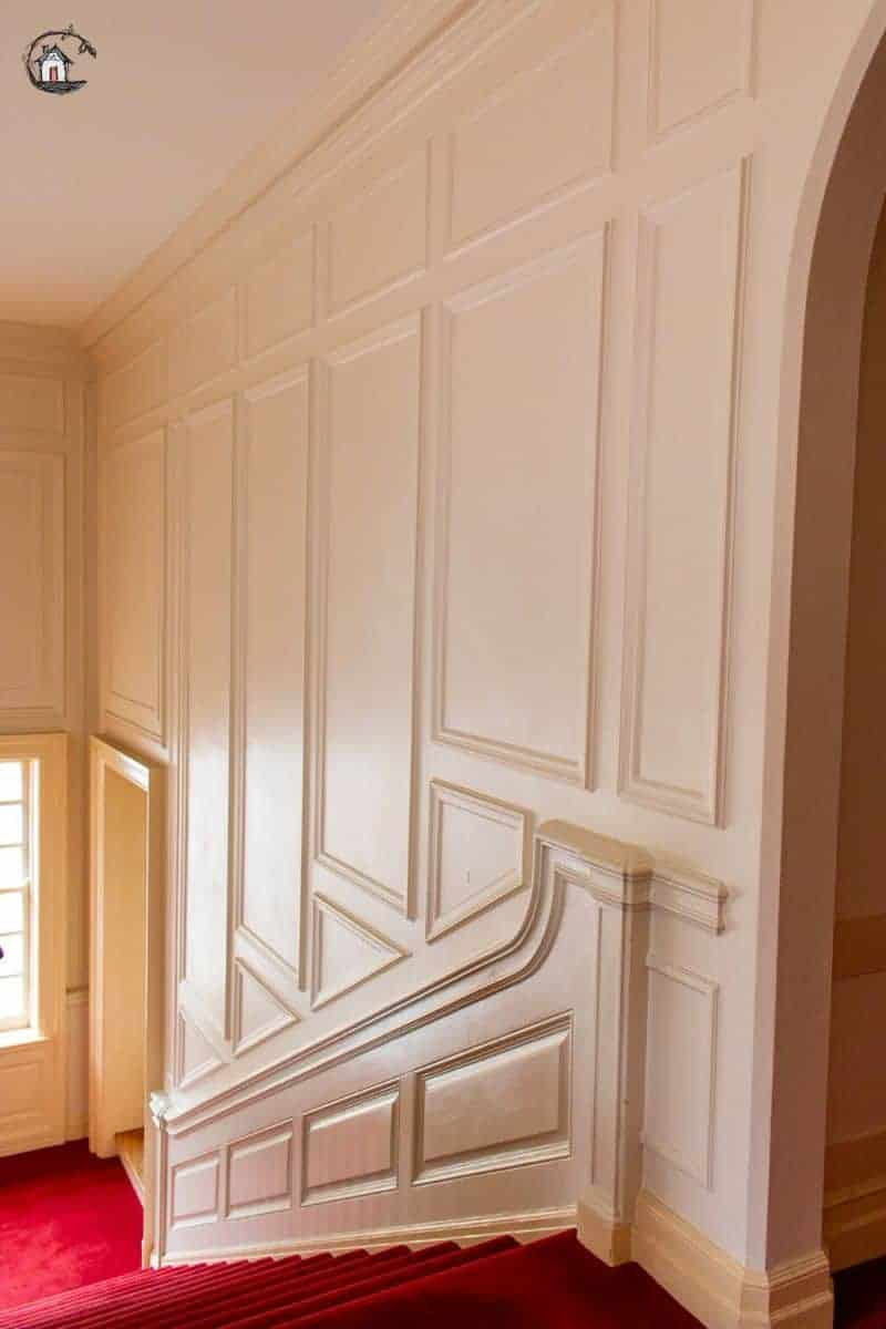 Photo of a paneled stairway in an old house. Old homes can teach new houses many important lessons.