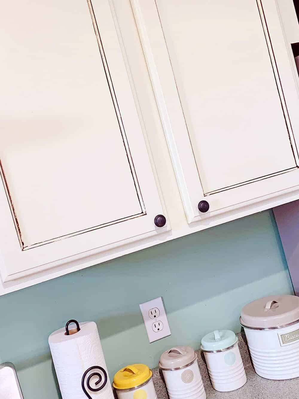 close up of white painted kitchen cabinets