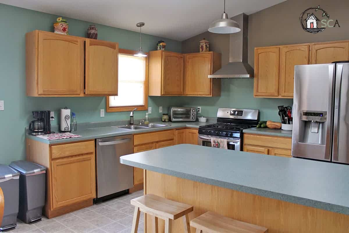 kitchen with orange cabinets (kitchen makeover before picture)