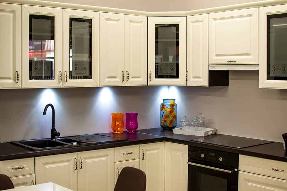 white kitchen cabinets with glass doors