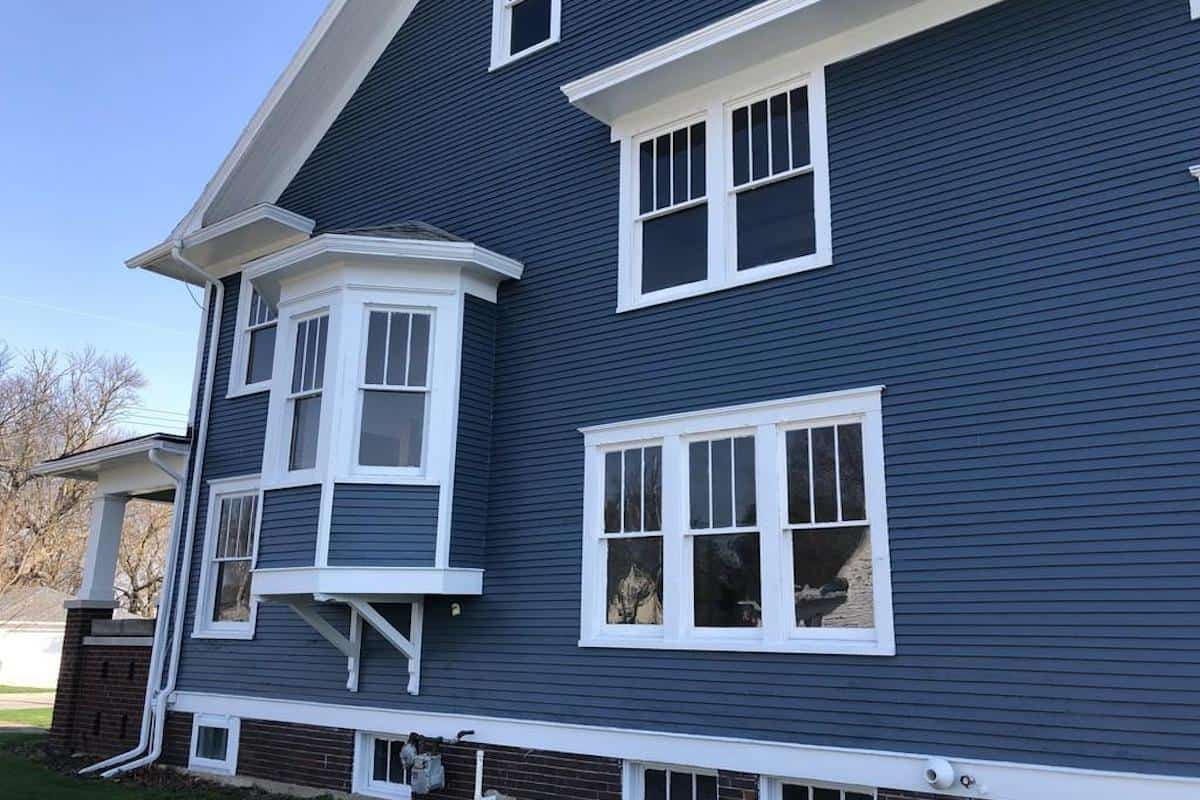 Photo of bay window on an American Foursquare home.