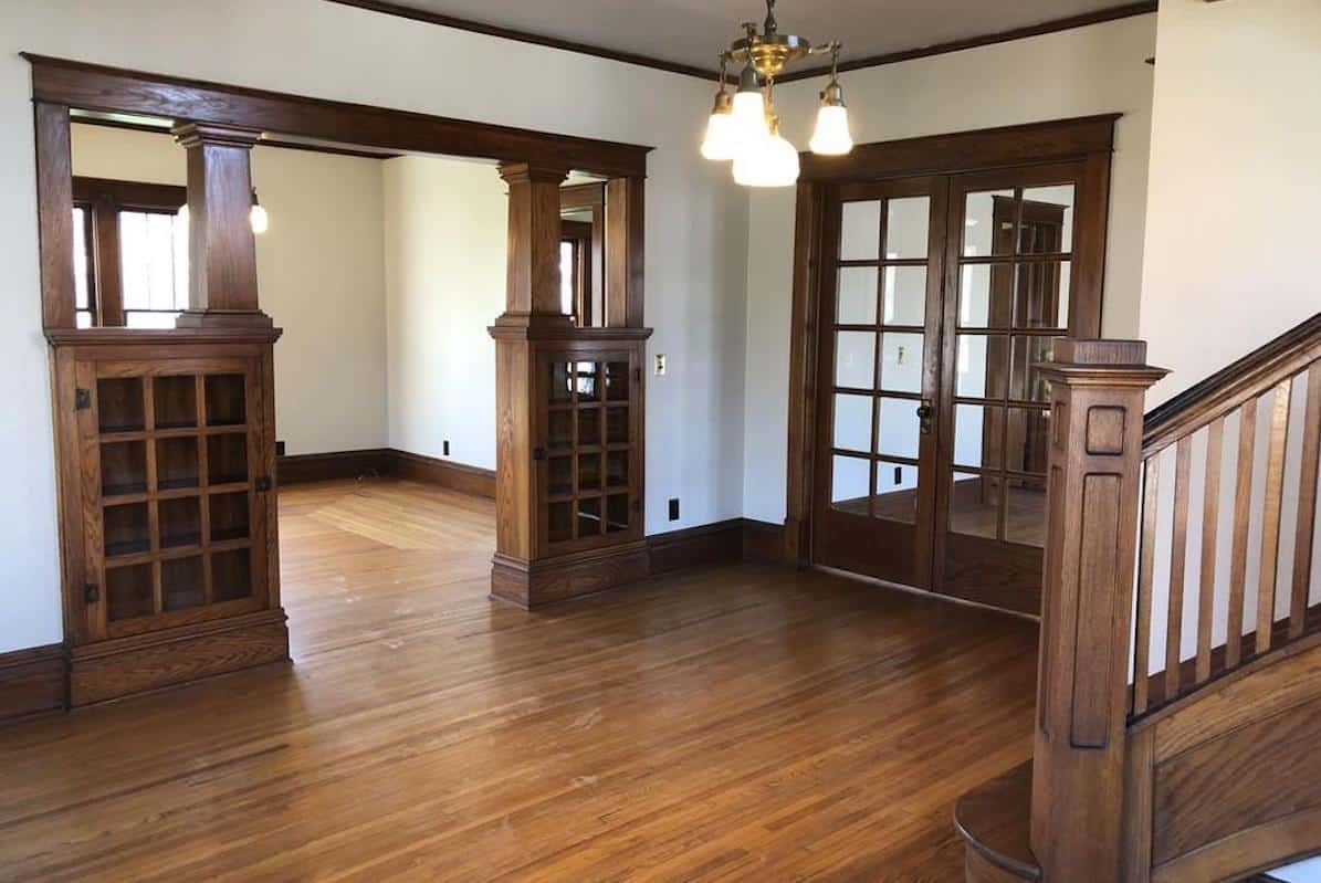 Photo of the interior of an American Foursquare home with built in Craftsman oak cabinets.