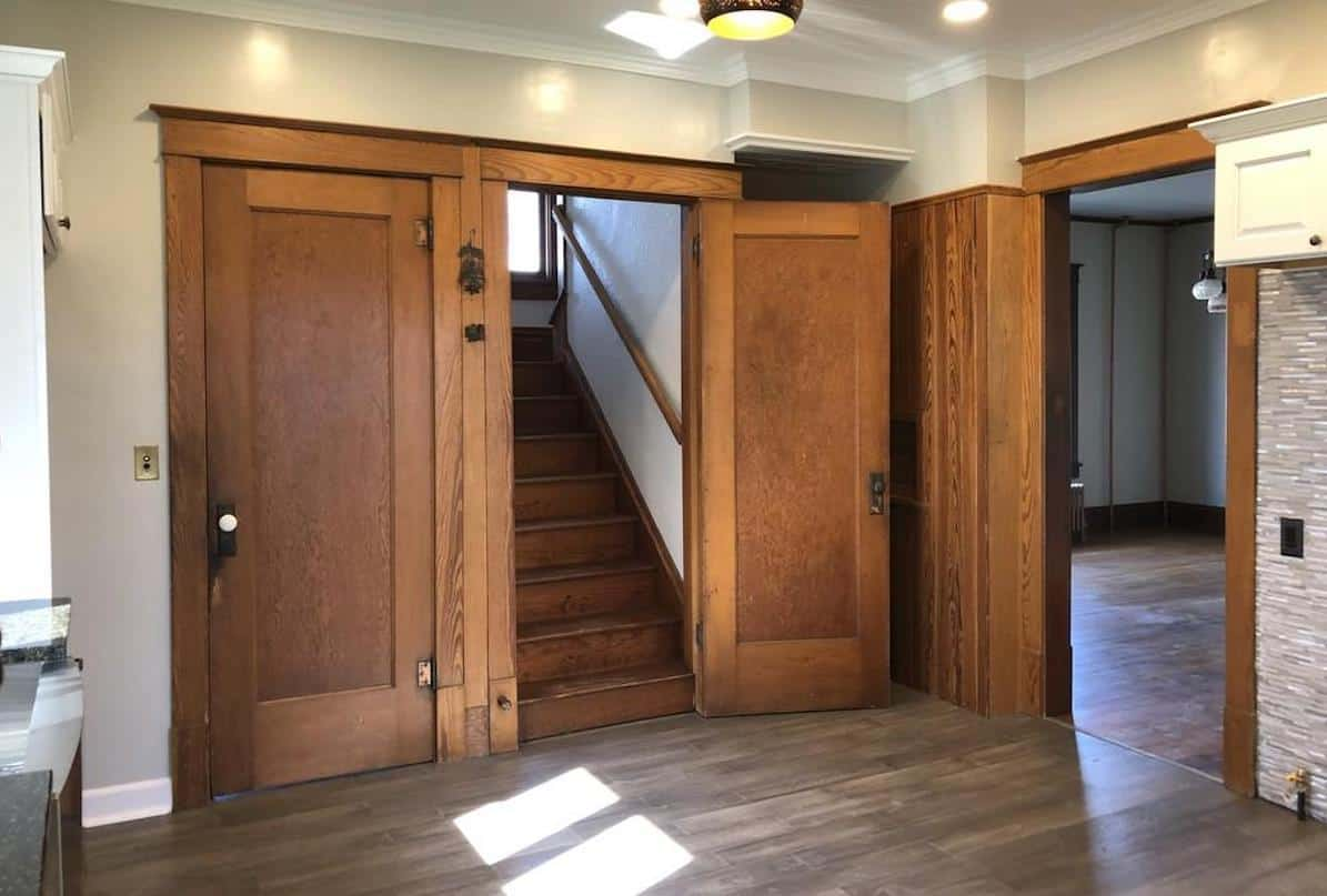 Photo of wooden Craftsman style doors in an American Foursquare style home.