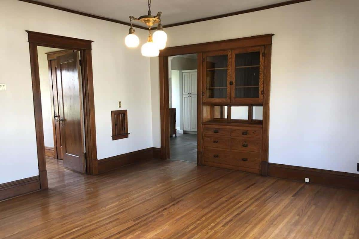 Photo of interior of an American Foursquare home with an oak built in china cabinet.